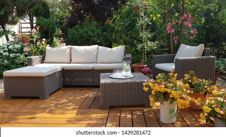 chairs and table on the patio on the garden