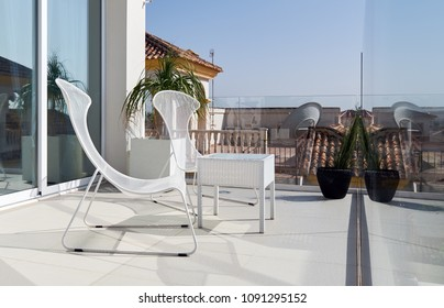 Chairs and table on a summer terrace. Spain