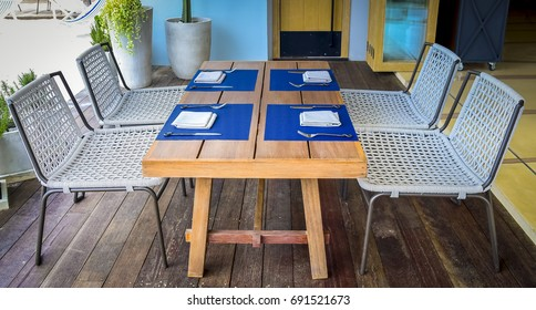 Chairs and table on wood floor at hotel balcony