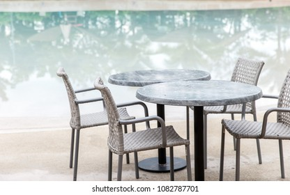 Chairs and Table with a part of swimming pool