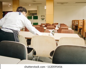 Chairs and tables in cafeteria without people. Clean because it was cleaned by the cleaning staff.