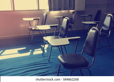 Chairs and tables in a classroom,vintage effect