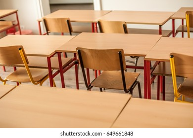 Chairs and tables inside empty classroom in primary school. Close up