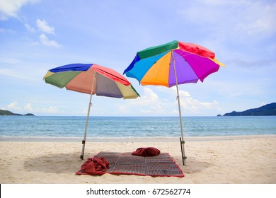Chairs and umbrella in  beach - tropical holiday.