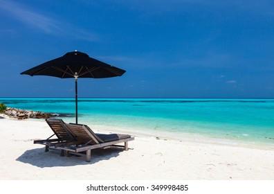 Chairs and umbrella on a beautiful tropical beach at Maldives