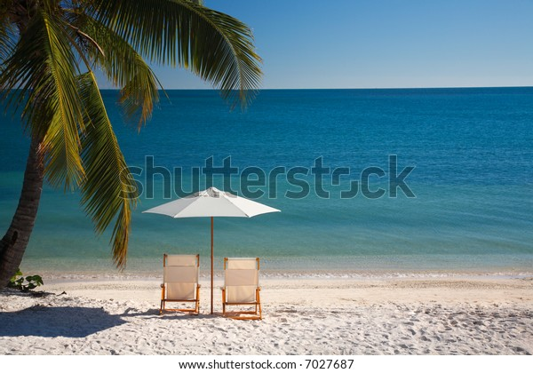 chairs and umbrella on a nice beach in the florida keys