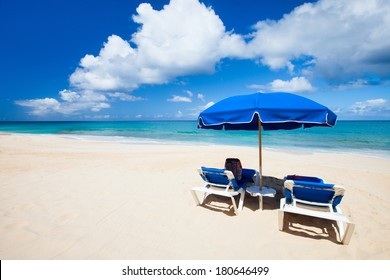 Chairs and umbrellas on a beautiful Caribbean beach