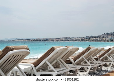Chairs and umbrellas on Nice beach, luxury view, summer vacation outdoor
