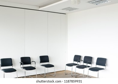 Chairs in waiting room white walls