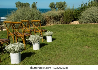 Chairs and wedding flowers on the lawn