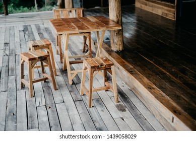 Chairs and wooden tables on wooden floor