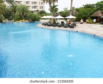 chaise longue and swimming pool in a hotel