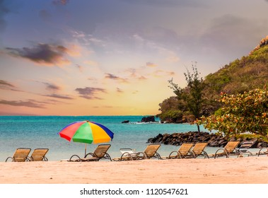 Chaise Lounges and Beach Umbrella