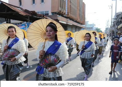 Chaiyaphum, Thailand - May 03: Woman in Thai traditional dress with white umbrella walk  at Merits Month Sixth parade from north-eastern part of Thailand on the May 03,2017 in Chaiyaphumi, Thailand.
