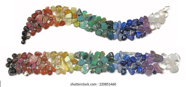 Chakra Healing Crystals  -   Multicolored chakra crystals in both a curve formation and a straight line on a white background