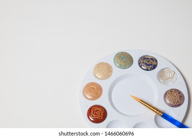 Chakra stones with a paint brush