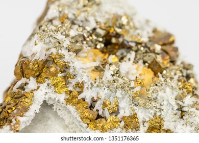 The Chalcopyrite (CuFeS2) contains Copper, Iron and Sulfur here in combination with Quartz