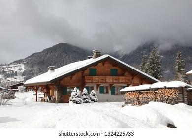 A chalet under the snow in a village in the French Alps