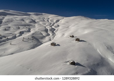 Chalets in mountain covered with snow. Winter landscape