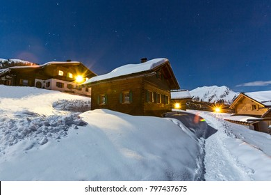 Chalets at night in winter