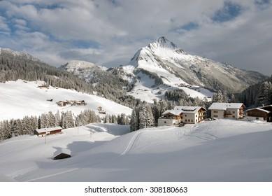 Chalets in the village of Warth-Schröcken, and Mount Biberkopf, Warth am Alberg,Vorarlberg, Austria