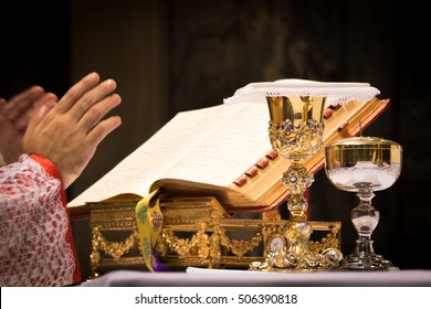 Chalice and ciborium on the altar during the traditional latin mass.