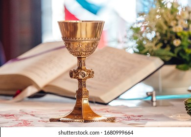 Chalice in front of bible at church