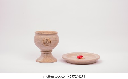 chalice and plate with heart on it