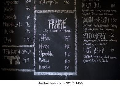 A chalk board with coffee menu items