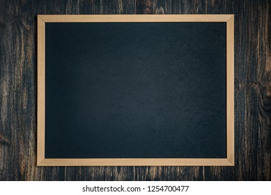 chalk board on a dark wooden background