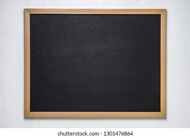 chalk board on a white wooden background