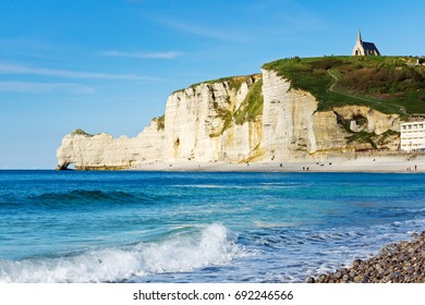 Chalk cliffs and coastline in Etretat, Normandy, France. Popular touristic destination