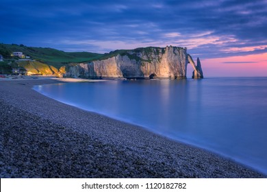 The chalk cliffs of Etretat after the sunset. Etretat, Normandy, France