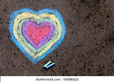 chalk drawing: colorful hearts on asphalt