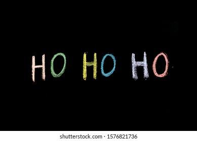 chalk drawn words ho ho ho on blackboard