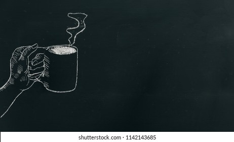 Chalk hand drawing a hand holding coffee cup with steam on black board on the left side of the frame.