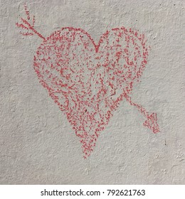 Chalk heart with arrow