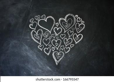 Chalk hearts drawn on a blackboard