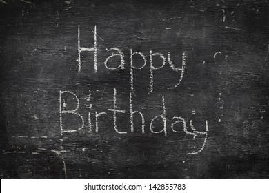 Chalk on black board: Happy birthday
