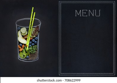 Chalk painted glass with fresh food ingredients for blending smoothie. Chalkboard smoothie bar menu.