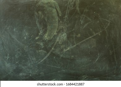 Chalk rubbed on black board in door Chiangmai Thailand