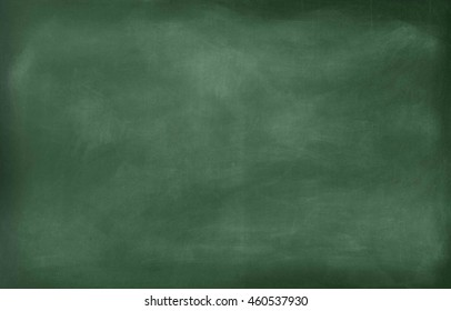 Chalk rubbed out on blackboard.School blackboard.Black blank chalkboard for background.Classroom blackboard.panel.Blank green chalkboard, blackboard texture with copy space. close up