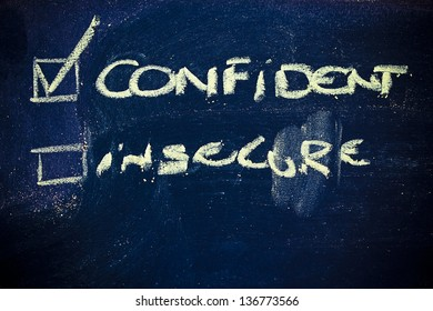 chalk writings on blackboard, choice between being confident or insecure
