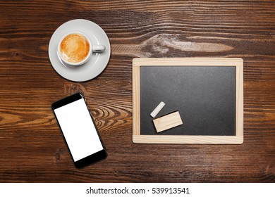 Chalkboard or Blackboard ready for text. Education or working concept. Stylish office background with coffee and mobile phone.