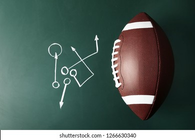 Chalkboard with football game scheme and rugby ball, top view