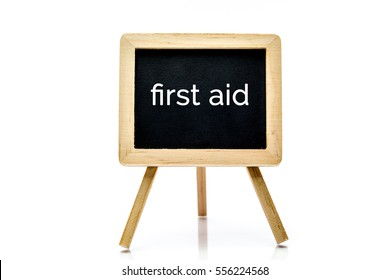 Chalkboard isolated on white background with first aid word title