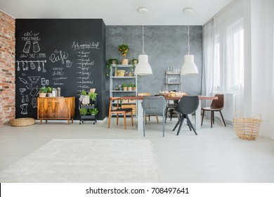 Chalkboard kitchen decor in open spacious dining room