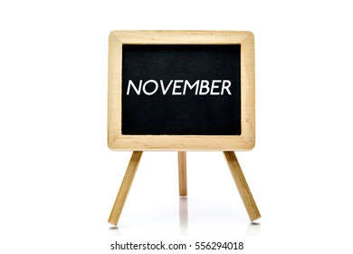 Chalkboard on isolated white background with november word title