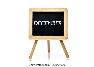 Chalkboard on isolated white background with december word title