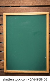 Chalkboard on a wooden table, for copyspace